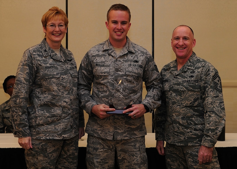Colonel Judith Hughes, 628th Medical Group commander, and Chief Master Sgt. Al Hannon, 628th Air Base Wing command chief, recognize Staff Sgt. Kristan Butler, 373rd Training Squadron, Detachment 5 instructor, as a Diamond Sharp award winner during a ceremony at the Charleston Club, Feb. 4, 2013, at Joint Base Charleston - Air Base, S.C. (U.S. Air Force photo/ Staff Sgt. Rasheen Douglas)