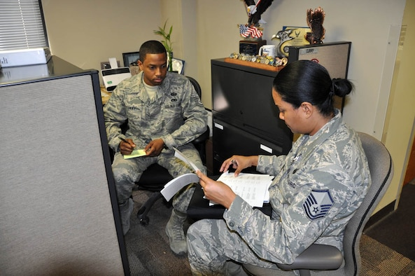 (Front) Master Sgt. Lashammia Kellam, Air Force Reserve Command inspection team member, goes through a records management checklist with Tech. Sgt. Natrell Curry, 926th Group base records manager, here Feb. 2 as part of the group's first Compliance Unit Inspection. (U.S. Air Force photo/Maj. Jessica Martin)