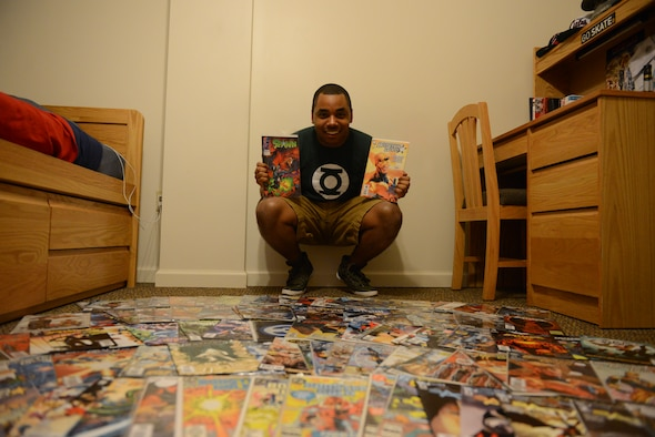 Airman 1st Class Jeremy Evans, 375th Communication Squadron, sorts through his comic book collection Monday in his dorm room at Scott Air Force Base.  Evans has an extensive collection of more than 1,000 comic books. (U.S. Air Force photo/Airman 1st Class Jake Eckhardt)