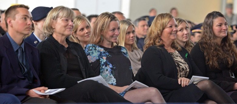U.S. Air Force Maj. Lucas Gruenther's family smiles during a video at a memorial service on Aviano Air Base, Italy, Feb. 6, 2013. Approximately 1,000 people attended the memorial service for Gruenther, who lost his life when his aircraft went down during a training mission on Jan. 28. (U.S. Air Force photo/Airman 1st Class Matthew Lotz)