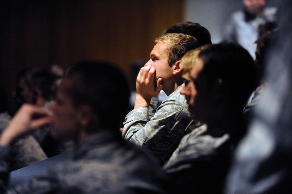 """Cadets watch a 17-minute preview of """"Inside Combat Rescue,"""" a National Geographic Channel TV series featuring Air Force pararescuemen deployed to Kandahar Airfield, Afghanistan, during a special presentation at the Air Force Academy Feb. 1, 2013. One of the officers featured in the series, HH-60 Pave Hawk pilot Maj. Devin Ryan, is a 2001 Academy graduate. (U.S. Air Force photo/Carol Lawrence)"""