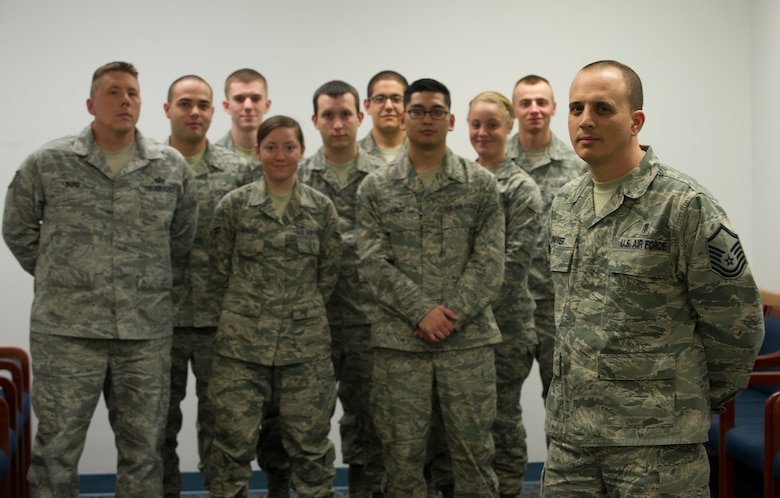 Master Sgt. Christopher Dwyer(Right), 49th Aerospace Medicine Squadron superintendent, stands with a group of his Airmen at the 49th Medical Group at Holloman Air Force Base, N.M., Feb. 5. Dwyer received the Air Force Medical Service Leadership Award for the Senior Non-Commissioned Officer class. (U.S. Air Force photo by Airman 1st Class Michael Shoemaker/Released)