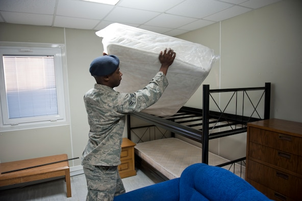 Airman 1st Class Darryl Davis, 39th Security Forces Squadron, ensures a bed frame in Patriot Village is properly assembled to meet the need of transiting or deployed service members Jan. 9, 2013, at Incirlik Air Base, Turkey. Currently, Patriot Village is housing soldiers supporting NATO's deployment of Patriot missile batteries. (U.S. Air Force photo by Senior Airman Clayton Lenhardt/Released)