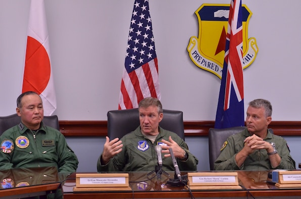 "Gen. Herbert ""Hawk"" Carlisle, Pacific Air Forces commander, responds to a question during a media roundtable for Cope North 13 at Andersen Air Force Base, Guam Feb. 4. Carlisle was joined by Lt. Gen. Masayuki Hironaka, Japan Air Self-Defense Force Air Support Command commander, and Air Commodore Anthony Grady, Royal Australian Air Force Air Combat Group commander, in discussing the relationship between the three partner militaries and how Cope North serves to prepare them for real-world response events.  Cope North is a multilateral aerial exercise, held once or twice yearly, designed to increase the combat readiness and interoperability of the U.S.