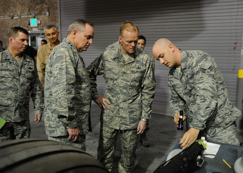 SOUTHWEST ASIA -- Senior Airman Paul Nessle, a non-destructive inspector from the 379th Expeditionary Maintenance Squadron, explains aircraft tire inspection procedures to Air Force Chief of Staff Gen. Mark A. Welsh III and Chief Master Sgt. of the Air Force James Cody during a tour of the 379th Air Expeditionary Wing. (U.S. Air Force photo/Master Sgt. Brendan Kavanaugh)