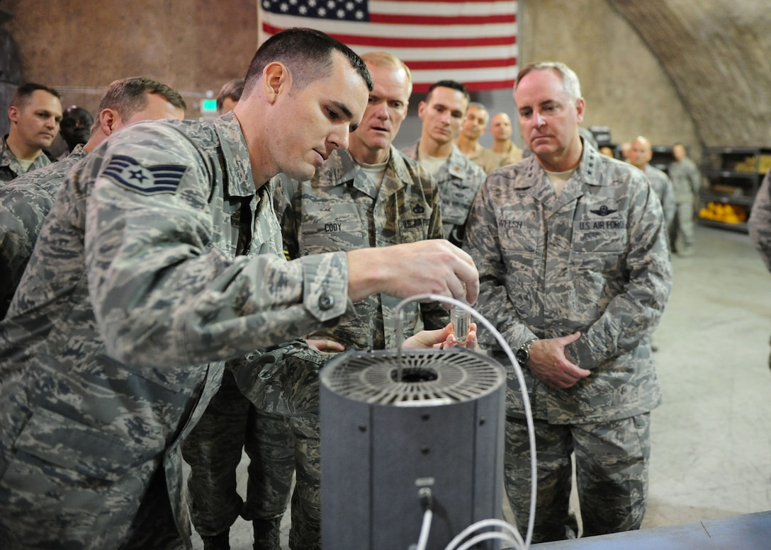 SOUTHWEST ASIA -- Staff Sgt. Joseph Stone, a test, measurement and diagnostic Equipment technician with the 379th Expeditionary Maintenance Squadron, demonstrates equipment used to test precision thermometers to Air Force Chief of Staff Gen. Mark A. Welsh III and Chief Master Sgt. of the Air Force James Cody during a tour of the 379th Air Expeditionary Wing. (U.S. Air Force photo/Master Sgt. Brendan Kavanaugh)