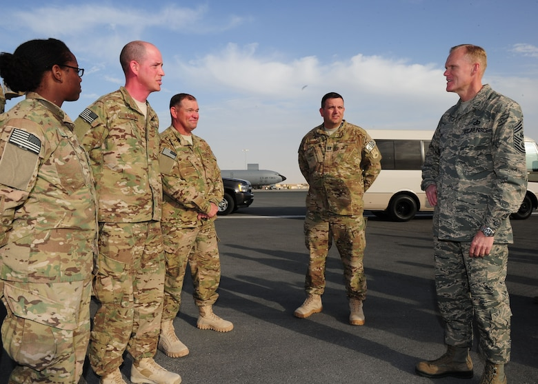 SOUTHWEST ASIA -- Chief Master Sgt. of the Air Force James Cody talks with explosive ordnance disposal Airmen of the 379th Expeditionary Civil Engineer Squadron during a visit to the 379th Air Expeditionary Wing. The visit is a part of a multi-base tour by Cody and Air Force Chief of Staff Gen. Mark A. Welsh III to meet with Airmen throughout the U.S. Central Command area of responsibility. (U.S. Air Force photo/Master Sgt. Brendan Kavanaugh)