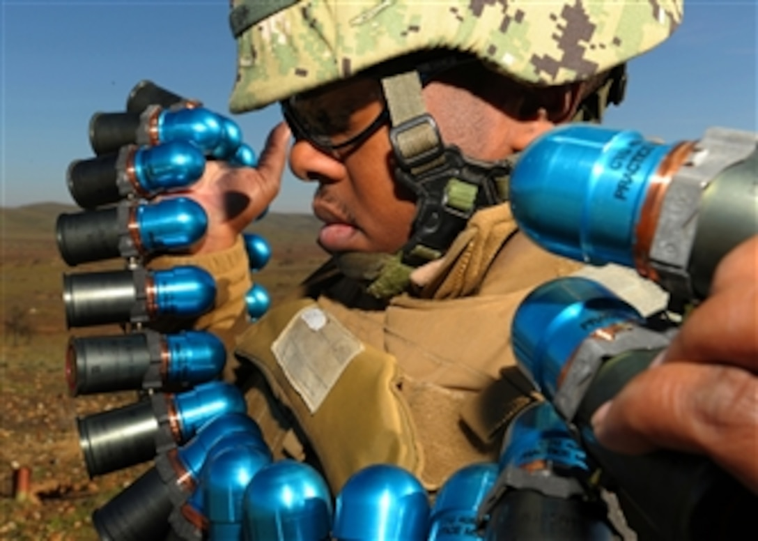 U S  Navy Constructionman William Reaws readies 40mm training
