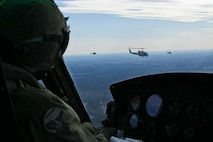 Marine Light Attack Helicopter Squadron 269 Marines bids fair winds and following seas to the UH-1N Huey on it final flight with the squadron with a parade across the skies of Marines Corps Air Station New River, Feb. 5. Two UH-1N Hueys were joined by its replacement a UH-1Y Huey and its partner in the sky, an AH-1W Cobra. After the flight, Col. Scott S. Jenson, Marine Aircraft Group 29 commanding officer, reflected on the history of the UH-1N Huey.