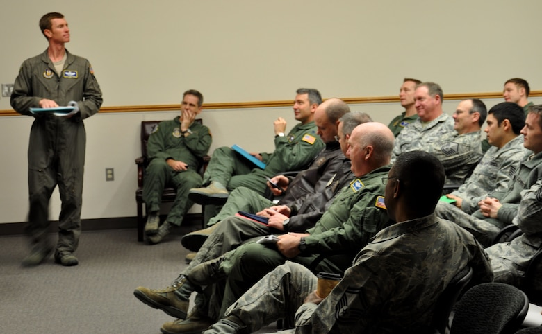 Lt. Col. Scott Amerman (left) takes role for an Operation Deep Freeze pre-departure briefing Jan. 6. The group of 35 Airmen from both the 446th and 62nd Airlift Wings are preparing to fly to Chrischurch, New Zealand to carry out the last nine missions of the ODF 2012-2013 season in Antarctica. (U.S. Air Force Photo/Airman 1st Class Madelyn McCullough)