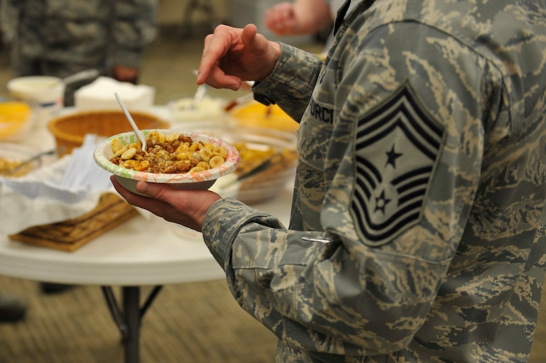Chief Master Sgt. William Ward, 460th Space Wing command chief, samples a bowl of chili at the 10th Annual Chili Cook-Off hosted by the Buckley Air Force Base Chapel Feb. 6, 2013, at the chapel Fellowship Hall. Following the chili cook-off, Team Buckley members were invited to partake in the chili as part of the monthly chapel luncheon. (U.S. Air Force photo by Airman 1st Class Riley Johnson/Released)