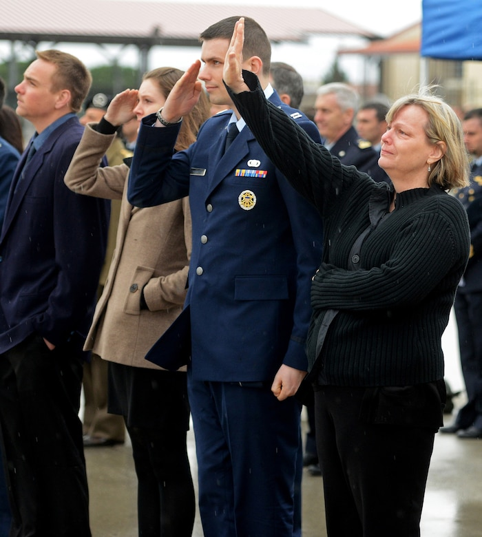 Romel Mathias, the mother of Maj. Lucas Gruenther, waves as a formation of F-16 Fighting Falcons flies over Aviano Air Base, Italy, Feb. 6, 2013. The flyover was part of a memorial service for Gruenther, who lost his life when his F-16 went down during a training mission Jan. 28. (U.S. Air Force photo/Staff Sgt. Justin Weaver)