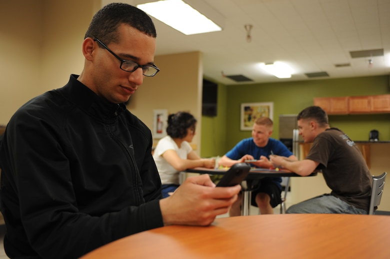Nowadays, it is not uncommon to see people messaging on their cell phones while in social settings. This can often lead to a person becoming disconnected with those around him. So, put down the phone and pick up a conversation. (U.S. Air Force photo by Senior Airman Timothy Moore/Released)