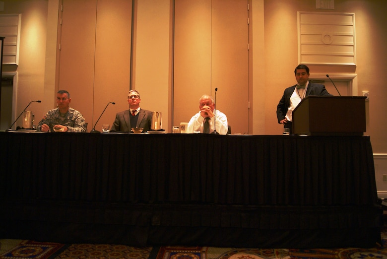 Col. Michael Teague,Tulsa District commander, Bob Portiss, Port of Catoosa director, and Steven Greetham, Chief General Counsel for the Chickasaw Nation Division of Commerce listen as panel moderator Cory Cox, Arkansas Land Commission Office addresses the audience during the Western States Land Commission Association winter meeting.