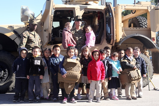 Marine Wing Support Squadron 273 motor transportation operators visited Michael C. Riley Elementary School, Jan. 31. The Marines were present to give insight to students during the school's carreer day.