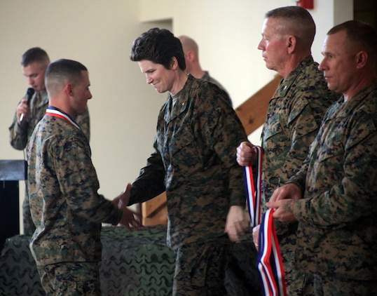 Brig. Gen. Lori Reynolds, commanding general of Marine Corps Recruit Depot Parris Island and Eastern Recruiting Region, presents awards to Marines who placed in the top 3 for each yard line at the 2013 Tri-Command Rifle and Pistol Intramural, Jan. 22. The competitors that demonstrated the professionalism to represent the Tri-Command Community and the desire to continue participating in marksmanship competitions were offered a chance to become a member of the Parris Island Rifle and Pistol Team.