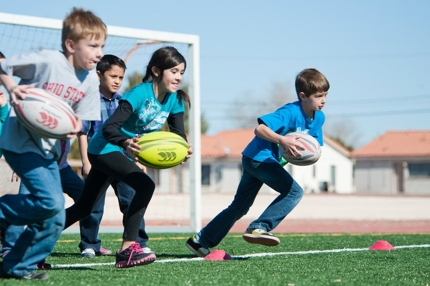 Lomie Heard Elementary School third grade students participate in a sprint race during a children's rugby clinic Feb. 6, 2013, at Nellis Air Force Base, Nev.  The clinic taught students basic rugby skills and fostered team work in a fun learning environment. (U.S. Air Force photo by Lawrence Crespo)
