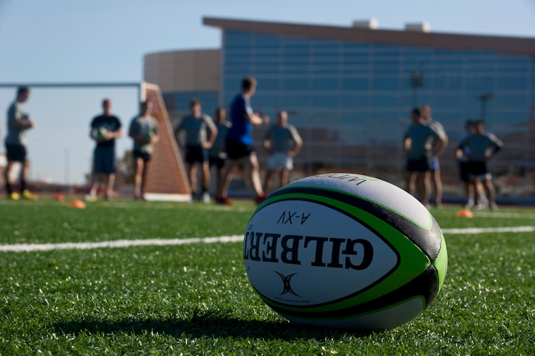 Members from U.S. military rugby teams practice drills during the military rugby clinic Feb. 6, 2013, at Nellis Air Force Base, Nev. Teams attending the clinic are preparing to play in the 2013 USA Sevens Rugby Tournament being held in Las Vegas Feb. 8-10, 2013. (U.S. Air Force photo by Senior Airman Matthew Lancaster)