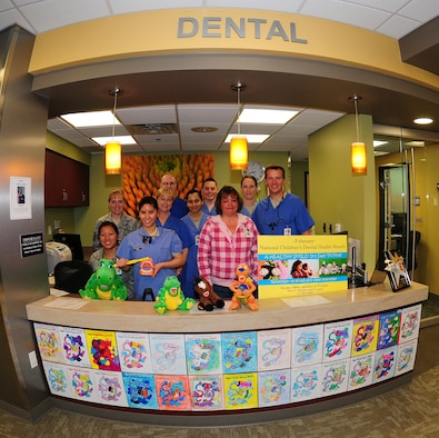 Members of the 9th Aerospace Medical Dental Squadron pose for a photo at the front desk of the clinic on Beale Air Force Base Calif., Feb. 8, 2013. February is National Children's Dental Health Month. (U.S. Air Force photo by Senior Airman Allen Pollard/Released)