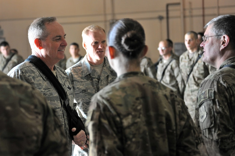 Air Force Chief of Staff Gen. Mark A. Welsh III and Chief Master Sgt. of the Air Force James Cody chat with Airmen of the 455th Expeditionary Aerial Port Squadron at Bagram Airfield, Afghanistan, Feb. 7, 2013. Welsh and Cody visited to discuss their priorities for the Air Force and thank the Airmen for their service. (U.S. Air Force photo/Senior Airman Chris Willis)