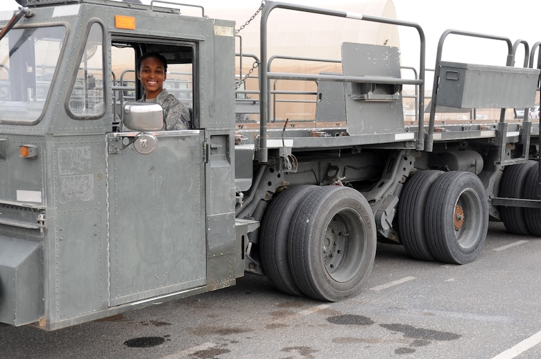 Senior Airman Denice Luke, 386th Expeditionary Logistics Readiness Squadron poses inside a 60 K-Loader at a base in Southwest Asia Feb. 8. Luke is serving on her first deployment from Robins Air Force Base Ga. to the Air Force Central Command Area of Responsibility. (U.S. Air Force photo by Senior Master Sgt. George Thompson)