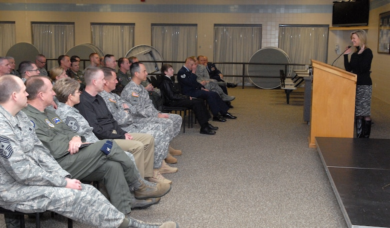"""Over 100 Guard members listened to a motivational speech by former Miss America 1985, Sharlene Wells-Hawkes, during the 5th Annual Interfaith Devotional at the Utah Air National Guard Base Feb. 10. During her speech, """"Building and Sustaining Faith,"""" Hawkes illustrated the similarities between faith and military training. (U.S. Air Force photo by Staff Sgt. Lillian Harnden)(RELEASED)"""