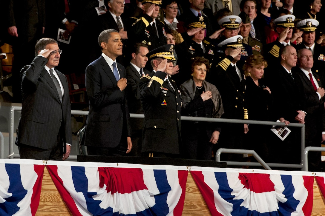 President Barack Obama, the chairman of the Joint Chiefs of Staff, General Martin Dempsey, and Secretary of Defense Leon E. Panetta stand for the national anthem during the armed forces farewell tribute in honor of Secretary of Defense Leon E. Panetta , Feb. 8, 2013. Panetta is stepping down as the 23rd Secretary of Defense.