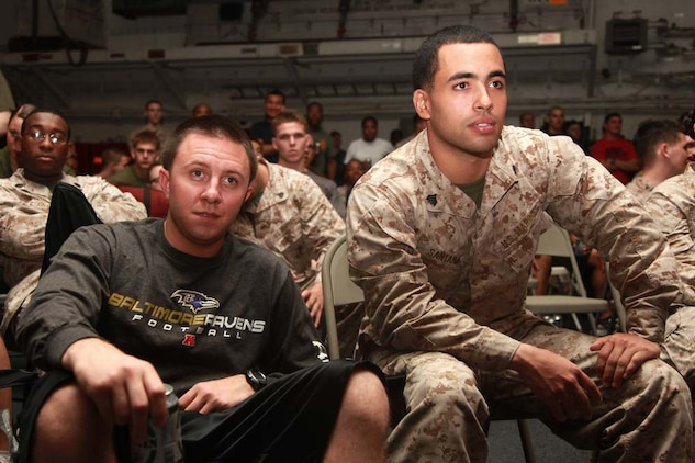 Sergeants Tim J. Kunkoski (left), motor transport non-commissioned officer-in-charge, and Yoen J. Santana, platoon sergeant, both with Transportation Support Detachment, Combat Logistics Battalion 15, 15th Marine Expeditionary Unit, watch Super Bowl XLVII during the Super Bowl party held in the hangar bay of the USS Peleliu, Feb. 4. The ship hosted a Super Bowl party for its Marines and sailors as a way to help them decompress and enjoy some of the comforts of home while being forward deployed. The 15th MEU is deployed as part of the Peleliu Amphibious Ready Group as a U.S. Central Command theater reserve force, providing support for maritime security operations and theater security cooperation efforts in the U.S. 5th Fleet area of responsibility. Kunkoski, 26, is from Baltimore, and Santana, 26, is from Brooklyn, N.Y.