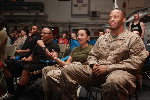 (Right to left) Sgt. Ketron L. Toomer, career planner, Cpl. Guadalupe Law, avionics technician, and Cpl. Shannon T. Burns, food service specialist, all with Marine Medium Helicopter Squadron 364 (Rein.), 15th Marine Expeditionary Unit, watch Super Bowl XLVII during the Super Bowl party held in the hangar bay of the USS Peleliu, Feb. 4. The ship hosted a Super Bowl party for its Marines and sailors as a way to help them decompress and enjoy some of the comforts of home while being forward deployed. The 15th MEU is deployed as part of the Peleliu Amphibious Ready Group as a U.S. Central Command theater reserve force, providing support for maritime security operations and theater security cooperation efforts in the U.S. 5th Fleet area of responsibility. Toomer, 24, is from Miami, Law, 23, is from Laredo, Texas, and Burns, 24, is from Detroit.