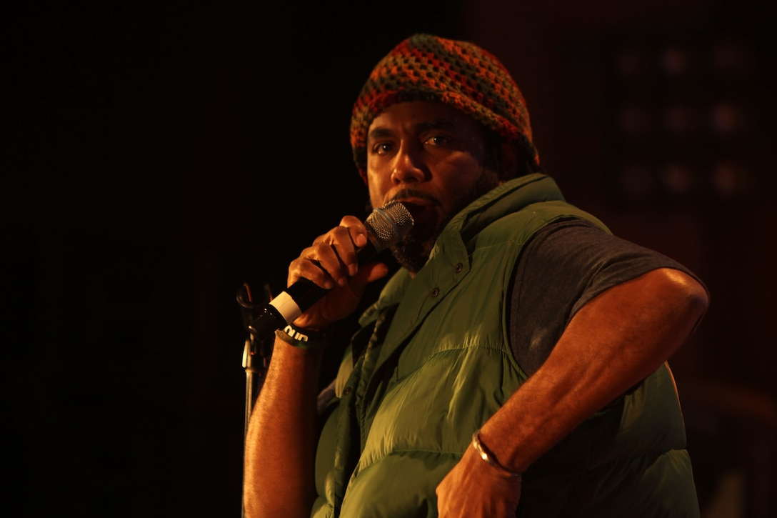 Comedian Alex Scott takes the stage during the 2013 Leatherneck Comedy and Entertainment Tour Feb. 1, at the Combat Center's Sunset Cinema.