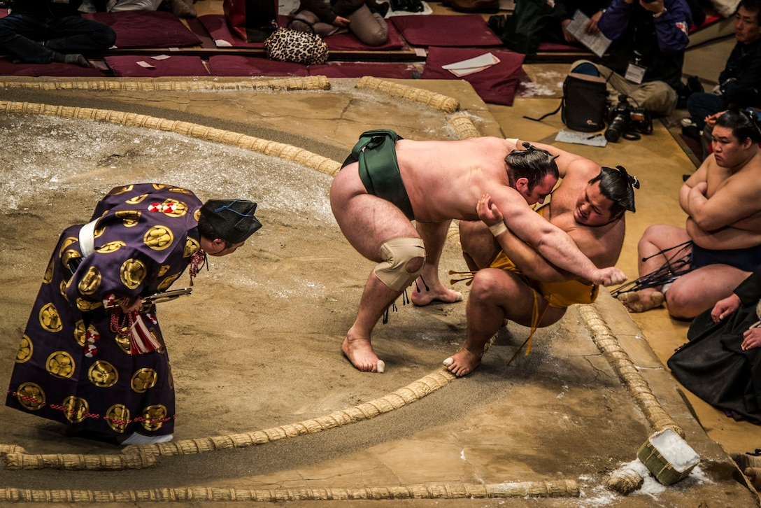 YOKOTA AIR BASE,Japan -- A Sumo wrestler pushes his opponent out of the ring during the Grand Sumo Tournament at the Ryogoku Kokugikan Sumo Hall in Tokyo, Feb. 10, 2013. During a Sumo match, two wrestlers, or rikishi, attempt to force one another out of a circular ring, or dohyo. A tournament features dozens of rikishi competing in an elimination-style roster to determine the champion. (U.S. Air Force photo by Capt. Raymond Geoffroy)