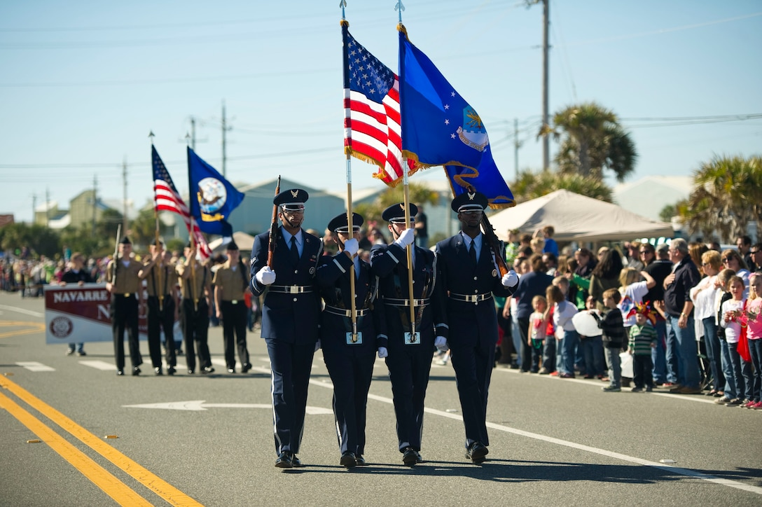 Honor Guardsmen from the 1st Special Operations Wing carry the colors during a mardi gras parade at Navarre Beach, Fla., Feb. 2, 2013. The 1st SOW also participated in the parade with a High Mobility Multipurpose Wheeled Vehicle. (U.S. Air Force photo / Tech. Sgt. Vanessa Valentine)