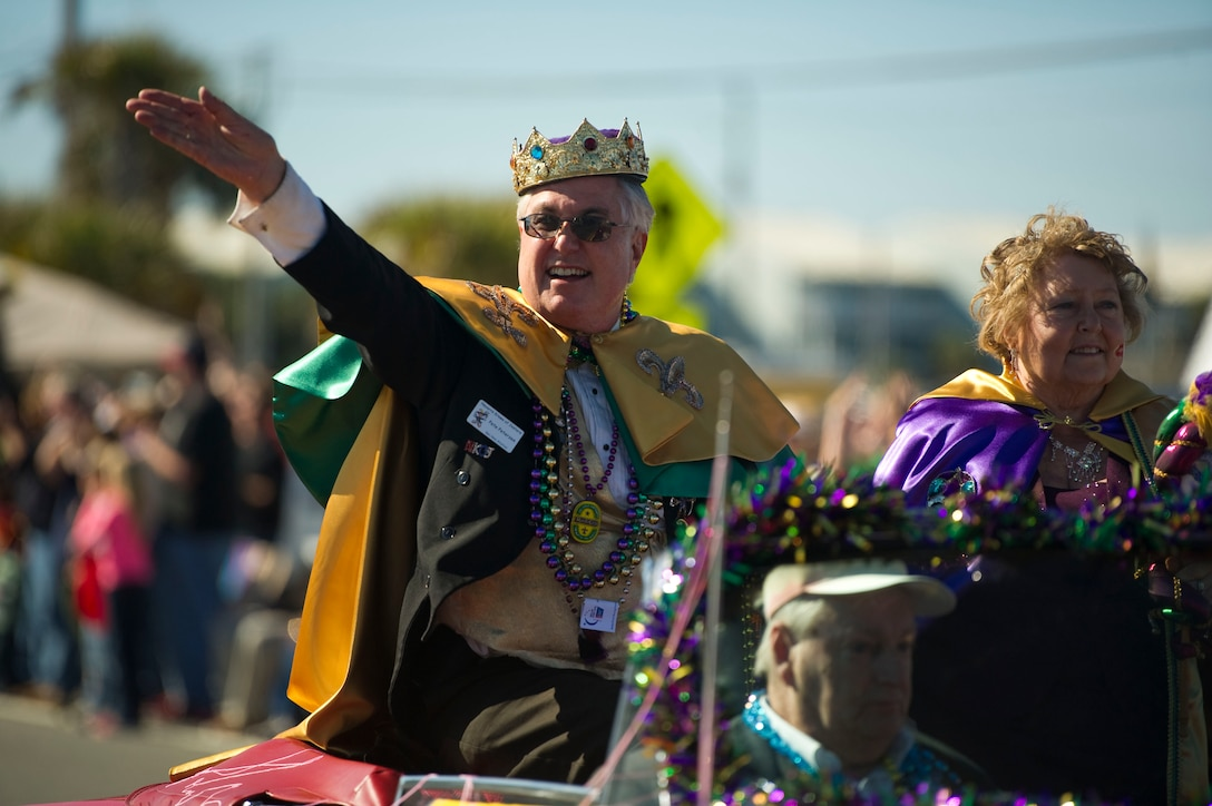 Pete Peterzen, king of the 2013 Navarre Krewe of Jesters, waves while riding on a float in a mardi gras parade at Navarre Beach, Fla., Feb. 2, 2013. More than 25,000 citizens attended the parade and its festivities. (U.S. Air Force photo / Tech. Sgt. Vanessa Valentine)