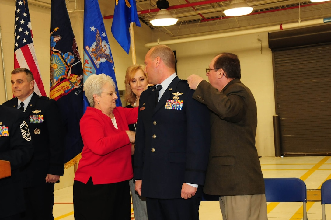 Many of Col. Bank's friends and family attended the assumption of command ceremony. His parents and wife pinned on his new colonel insignia as he was promoted. Feb, 10, 2013 (Air National Guard Photo/Senior Master Sgt. Ray Lloyd)