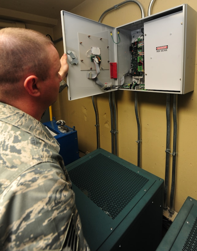 WHITEMAN AIR FORCE BASE, Mo. -- Staff Sgt. Clint Smith, 509th Civil Engineer Squadron electrical systems craftsman, inspects an electrical box, Jan. 29. The electrical box shows electricians the status of the amperage and current of an electrical system. (U.S. Air Force photo/Staff Sgt. Nick Wilson) (Released)