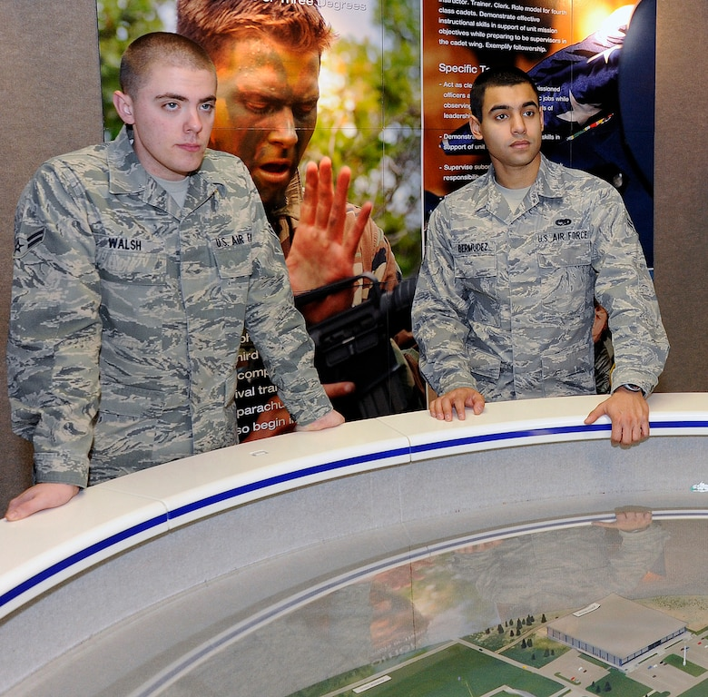 Airmen 1st Class James Walsh and Daniel Bermudez tour the Air Force Academy Visitor Center Jan. 14, 2011, during a Leaders Encouraging Airmen Development orientation. Both were selected for entry into the Academy Preparatory School and into the Academy's Class of 2016. (U.S. Air Force photo/Mike Kaplan)