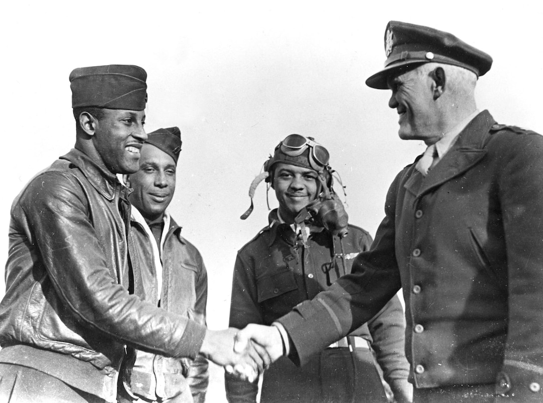 Capt. Charles B. Hall (left), the first Tuskegee Airman to shoot down an enemy plane, is congratulated by Maj. Gen. John Kenneth Cannon. (U.S. Air Force photo)