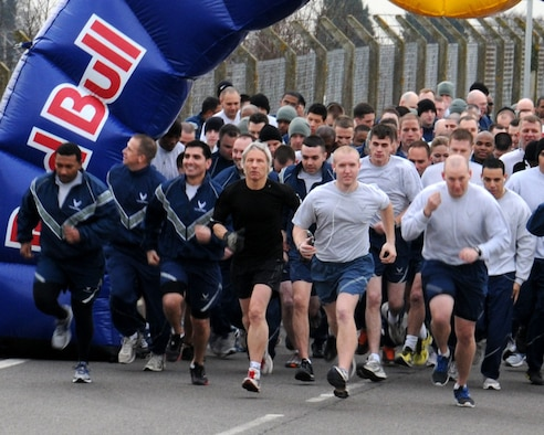 Team Mildenhall members take part in the monthly wing run Feb. 8, 2013, on Perimeter Road near the Hardstand Fitness Center on RAF Mildenhall, England. The run takes place on the first Friday of every month and is mandatory for all 100th Air Refueling Wing military personnel but tenant units and base ID card holders 13-years and older are welcome to attend. (U.S. Air Force photo by Gina Randall/Released)