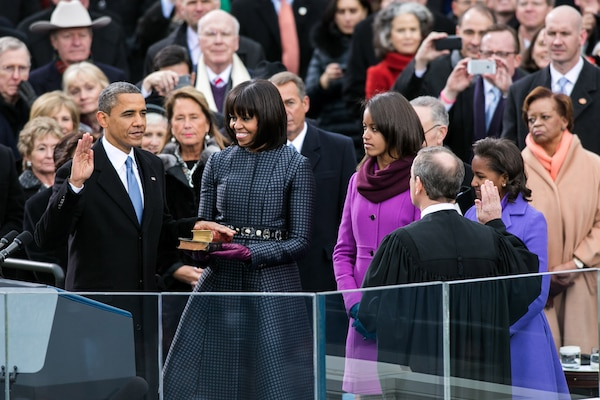Supreme Court Chief Justice John Roberts (right) administers the oath of office to President Barack Obama during the inaugural swearing-in ceremony at the U.S. Capitol in Washington, D.C., Jan. 21, 2013. First Lady Michelle Obama holds a Bible that belonged to Dr. Martin Luther King Jr., and the Lincoln Bible, which was used at President Obama's 2009 inaugural ceremony. Daughters Malia and Sasha stand with their parents.