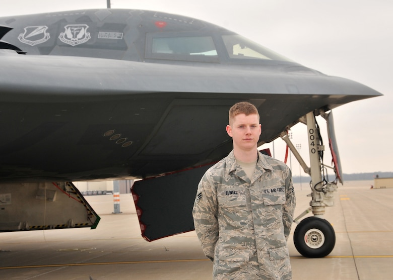 Senior Airman Joseph  Elwell, 131st Bomb Wing, is the 2012 Airman of the Year for the Missouri Air National Guard. Elwell, pictured here with a B-2 Stealth Spirit at Whiteman Air Force Base, is attending Central Missouri State University where he is studying computer information systems. (National Guard photo by Senior Master Sgt. Mary-Dale Amison)