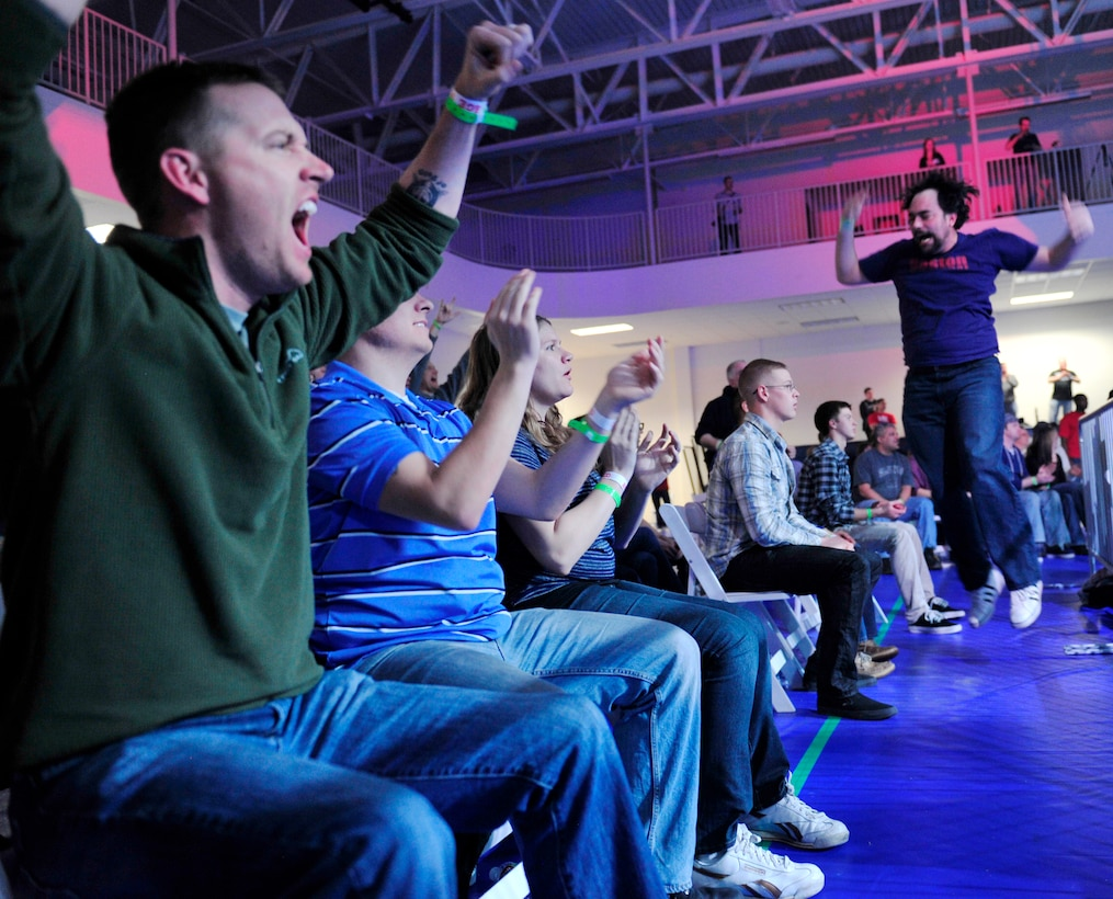 The crowd cheers after watching Tyler Toner, an Aurora native, claim victory over Cody Carrillo Feb. 9, 2013, at the Buckley Air Force Base Fitness Center. The 460th Force Support Squadron hosted the Buckley MMA Fight Night. (U.S. Air Force photo by Airman 1st Class Darryl Bolden Jr./Released)
