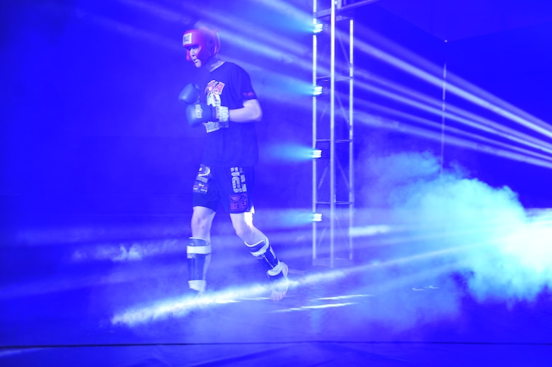 "Mixed martial artist Rick ""The Reach"" Van Seters walks out to the ring for his debut fight Feb. 9, 2013, at the Buckley Air Force Base Fitness Center. Van Seters, an Airman with the 460th Space Communications Squadron, fought against James Nakashima at the Buckley MMA Fight Night. The judges declared Nakashima the victor. (U.S. Air Force photo by Airman 1st Class Darryl Bolden Jr./Released)"