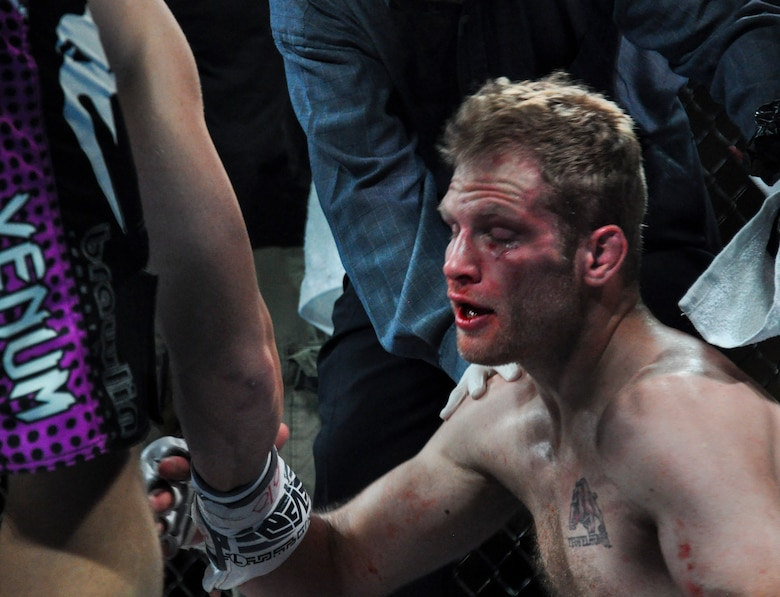 "A bloodied Reed O'Malley congratulates his opponent Todd ""Captain America"" Meredith after a brutal battle Feb. 9, 2013, at Buckley MMA Fight Night. Meredith won by technical knockout in the first round after delivering bone-crushing blows to O'Malley's face from the mount position. (U.S Air Force photo by Staff Sgt. Nicholas Rau/Released)"