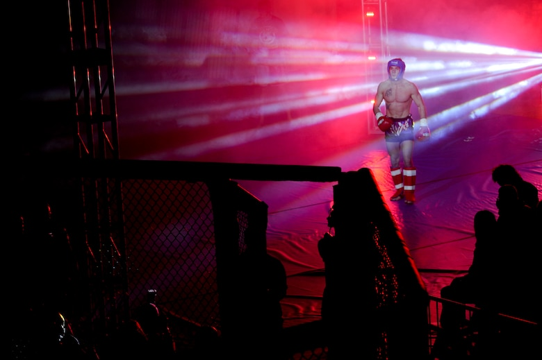 "James Nakashima makes an entrance at Buckley MMA Fight Night Feb. 9, 2013, Buckley Air Force Base.  Nakashima claimed victory over Rick ""the Reach"" Van Seters in the first round of the night. This was also the first-ever mixed martial arts fight on a military installation in Colorado. Van Seters is a member of the 460th Space Communications Squadron and one of several military members that competed. (U.S. Air Force photo by Airman 1st Class Phillip Houk/Released)"