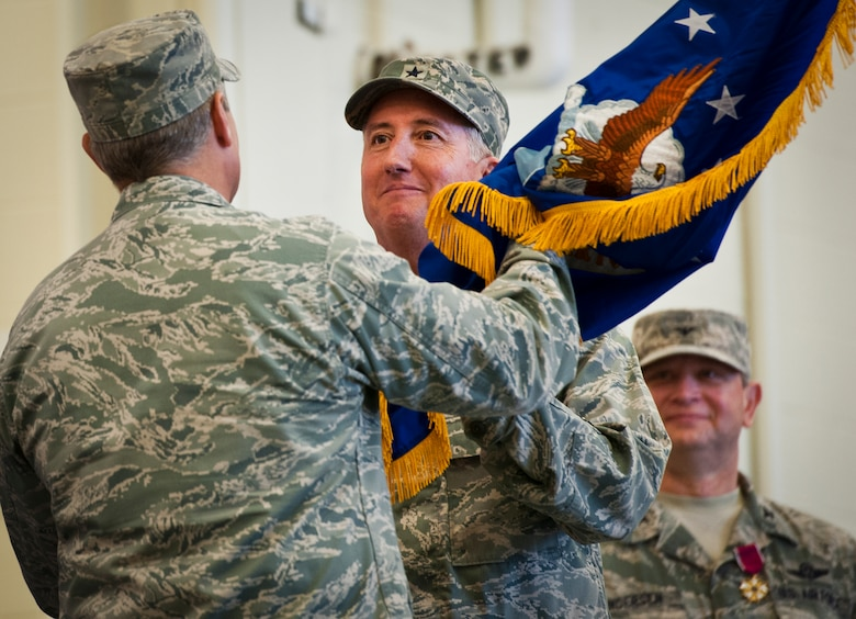 Former 919th Special Operations Wing commander, Brig. Gen. Jon Weeks accepts the Air Force Special Operations Air Warfare Center guidon as its first leader at an activation ceremony at Duke Field, Fla., Feb. 11.  The new center is Weeks' third special operations command.  The AFSOAWC will combine the efforts of units across AFSOC that work with doctrine development, education, training and execution of the command's irregular warfare capabilities.  The center will bring together more than 500 active-duty and reserve Airmen through total force integration.  (U.S. Air Force photo/Tech. Sgt. Samuel King Jr.)