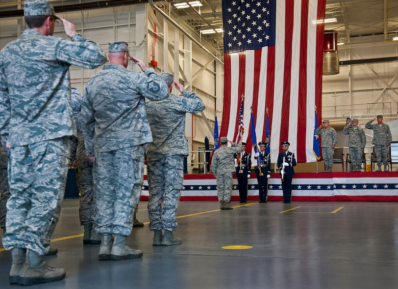 Air Force Special Operations Command Airmen and leadership salute the flag during the National Anthem at the Air Force Special Operations Air Warfare Center activation ceremony at Duke Field, Fla., Feb. 11.  Former 919th Special Operations Wing commander, Brig. Gen. Jon Weeks assumed command of the center.  The AFSOAWC will combine the efforts of units across AFSOC that work with doctrine development, education, training and execution of the command's irregular warfare capabilities. The center will bring together more than 500 active-duty and reserve Airmen through total force integration.   (U.S. Air Force photo/Tech. Sgt. Samuel King Jr.)