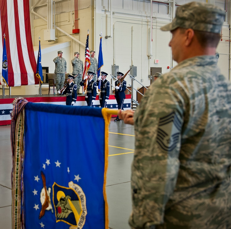 Chief Master Sgt. Tyler Outten, of the 919th Special Operations Wing, holds the wing guidon as the colors are brought in during the activation ceremony of the Air Force Special Operations Air Warfare Center at Duke Field, Feb. 11.  Former 919th Special Operations Wing commander, Brig. Gen. Jon Weeks assumed command of the center.  The AFSOAWC will combine the efforts of units across AFSOC that work with doctrine development, education, training and execution of the command's irregular warfare capabilities. The center will bring together more than 500 active-duty and reserve Airmen through total force integration.   (U.S. Air Force photo/Tech. Sgt. Samuel King Jr.)