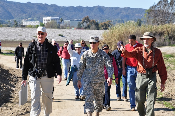 (Left to right) San Fernando Valley Audubon Society President Dave Weeshof, Los Angeles District Commander Col. Mark Toy and SFVAS Conservation Chair Kris Ohlenkamp lead a group of Corps employees and local environmentalists on a nature walk Feb. 12 at the Sepulveda Dam Basin vegetation management area. (USACE photo by Jay Field)