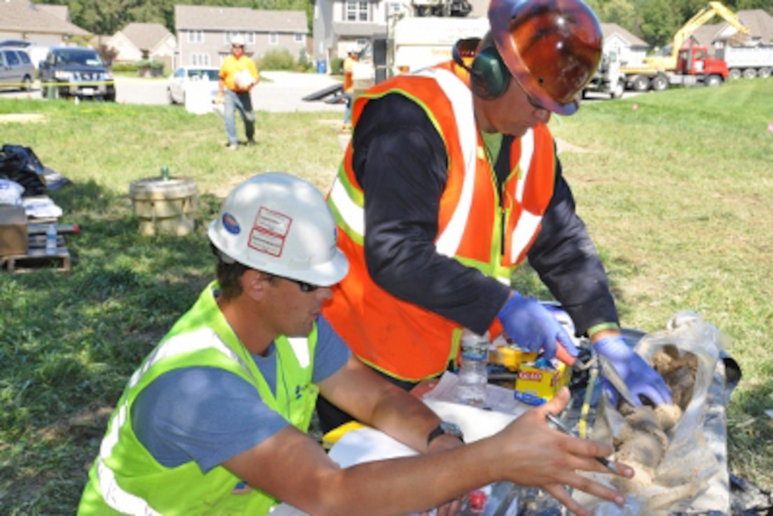 Contractor employees work at Nike C-32 Missile Site to investigate soil samples.