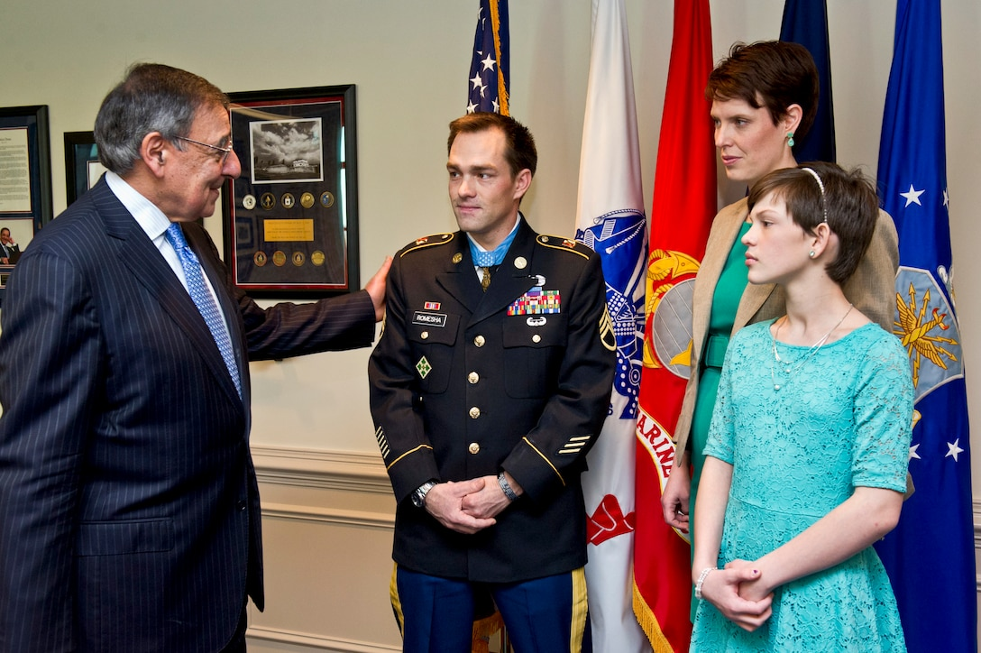Defense Secretary Leon E. Panetta visits with former Army Staff Sgt. Clinton L. Romesha and his family in his office at the Pentagon, Feb. 12, 2013. Romesha received the Medal of Honor during a ceremony at the White House, Feb. 11, 2013. DOD photo by Erin A. Kirk-Cuomo